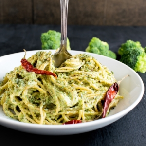 a fork rolling in Spicy Garlic Spaghetti in Broccoli Cheese Sauce