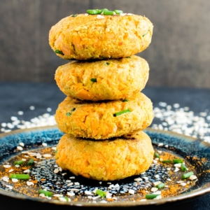 A plate stacked with Carrot Oatmeal Breakfast Patties