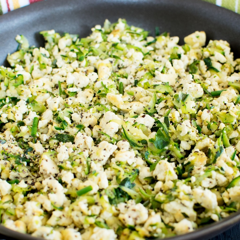 Tofu Zucchini Herb Scramble is a wholesome and protein rich morning meal with delicious flavors. Tofu in this scramble is complimented with freshly grated zucchini and cooked with fresh herbs. It is a delightful and filing morning meal for weekdays or a quick brunch for weekends. It's easy to cook and takes only about 20 minutes to be ready [ vegan + GF ] kiipfit.com