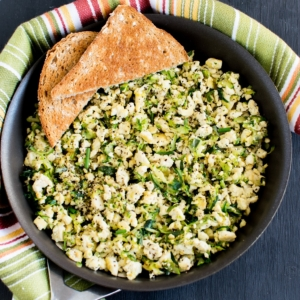 Top view of Tofu Zucchini Herb Scramble with toast