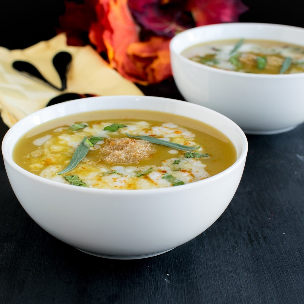 A close up front view of the soup in the serving bowls.