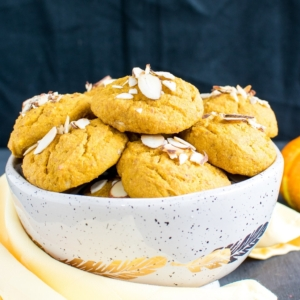 A bowl stacked with Almond Butter Pumpkin Oatmeal Cookies