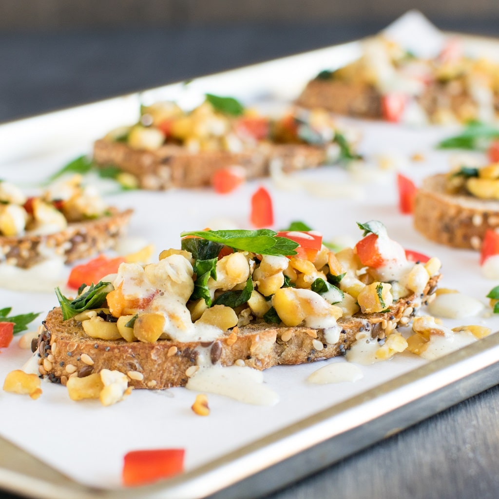 A closer front angle view of Herbed Cashew Cream Tempeh Crostini