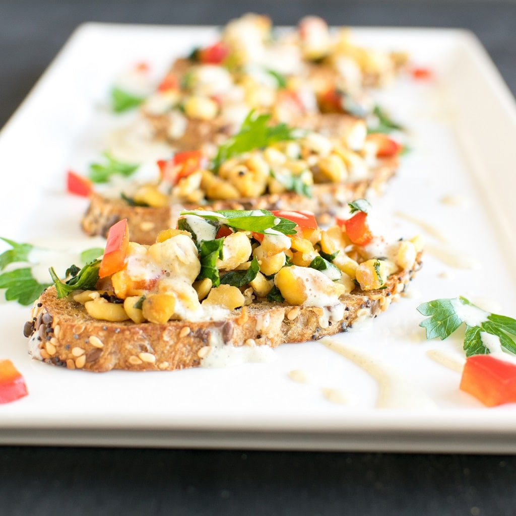 An array of Herbed Cashew Cream Tempeh Crostini is shown