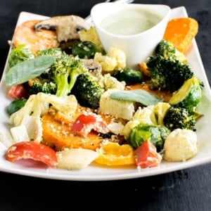 A front view of Vegan Herb Hemp Roasted Vegetables is made with fiber rich vegetables and tossed in mouthwatering hemp seed dressing. It's not only delicious but is also nutrient dense. This side dish is packed with absolutely desirable ingredients and is a crowd pleaser. Vegan Herb Hemp Roasted Vegetables