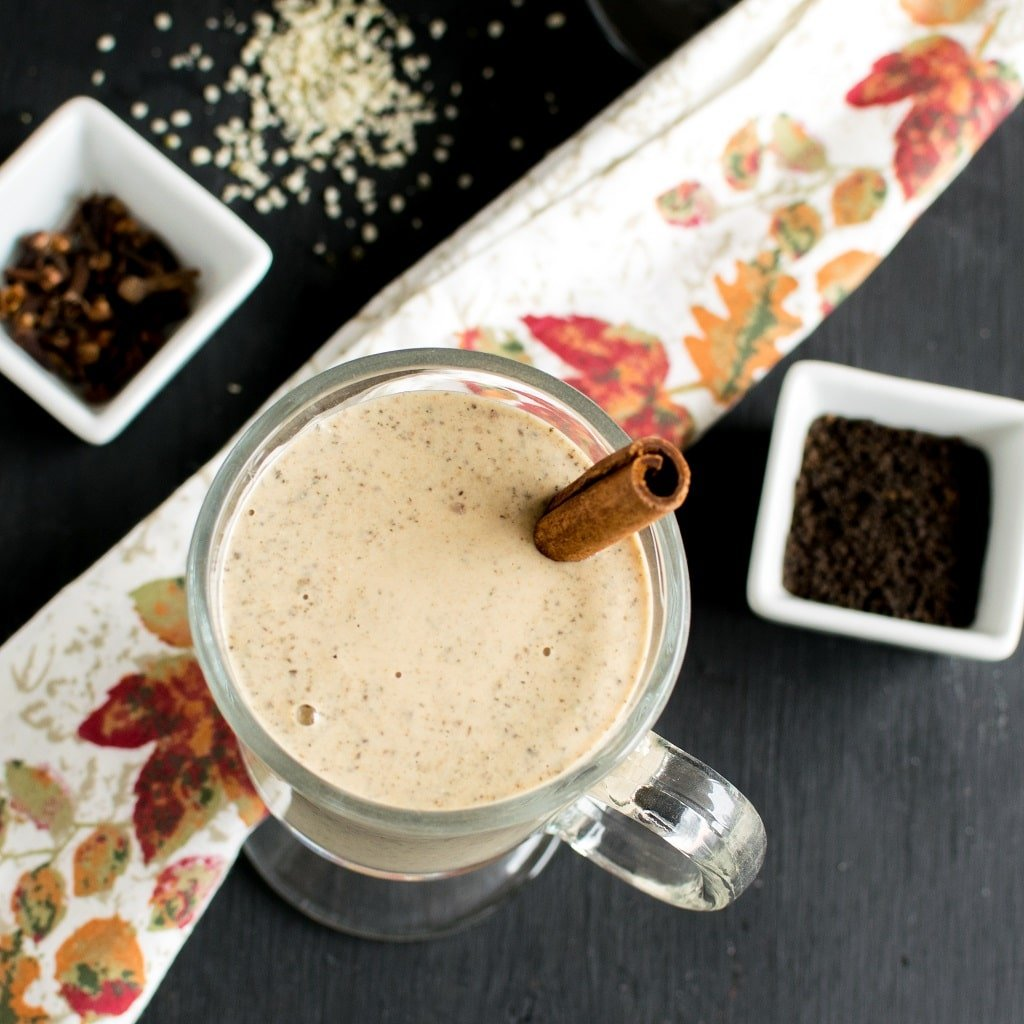The top view of Masala Chai Protein Smoothie is shown in the image with raw ingredients as the props | kiipfit.com