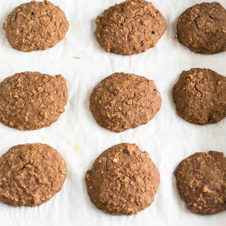 Vegan Mocha Oatmeal Cookies are shown on a cookie sheet fresh out of the oven.