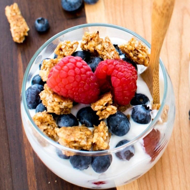 The top view of Healthy Breakfast Vegan Yogurt Parfait is displayed.