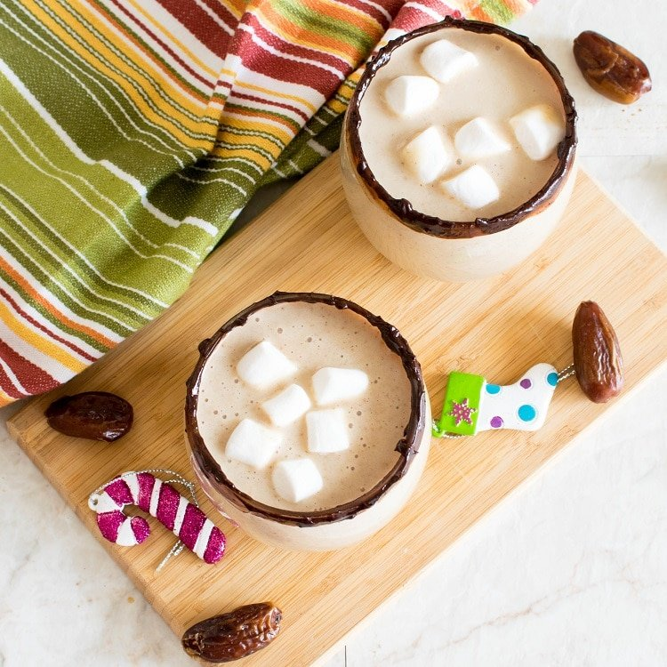 Salted Caramel Oatmeal Smoothie loaded with vegan marshmallows with a Christmas ornaments as backdrop