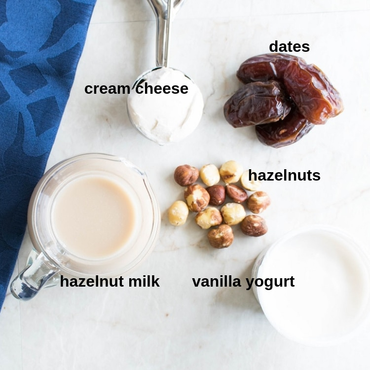 Top view of all the ingredients of Hazelnut Cheesecake Smoothie