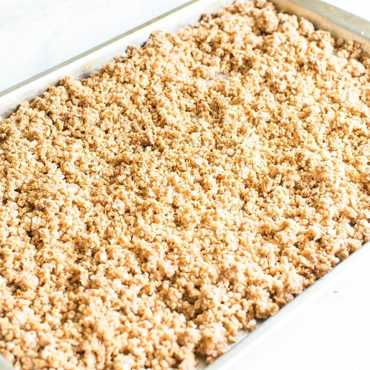 Baked Vegan White Chocolate Quinoa Granola on a baking sheet