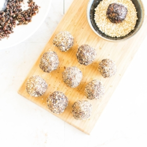 No Bake Chocolate Quinoa Protein Balls on wooden board with a top view