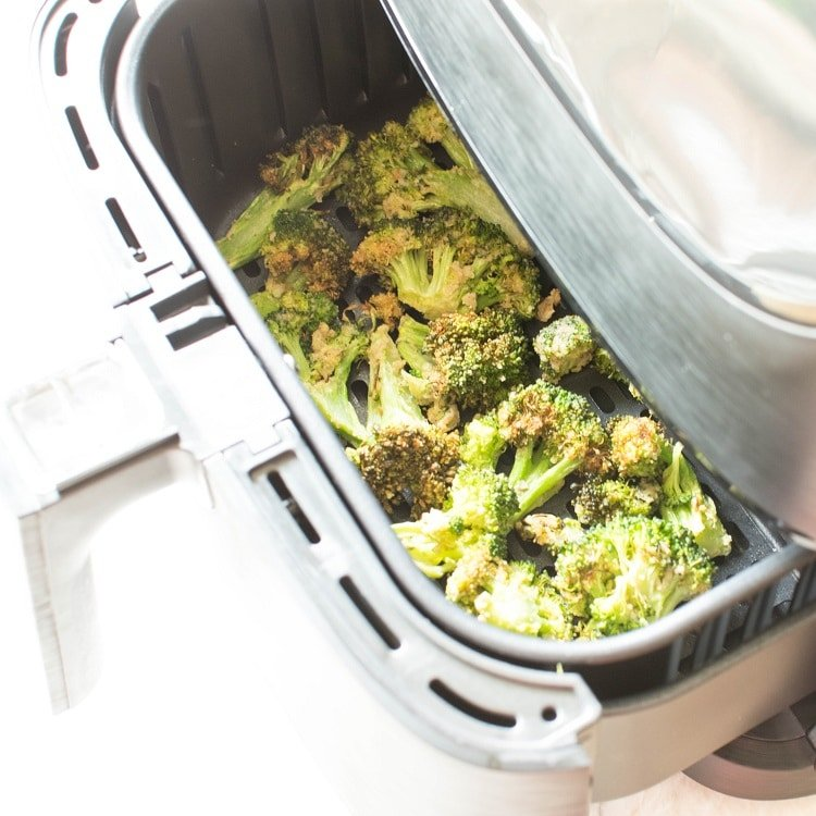 Top view of crispy broccoli in the air fryer