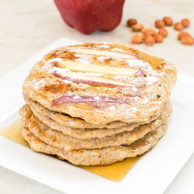 Front view of the stack of Peanut Butter Apple Pancakes with the ingredients as the prop