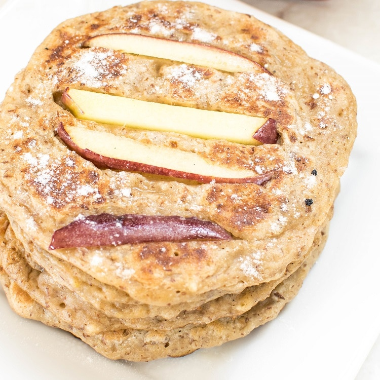 Peanut Butter Apple Pancakes dusted with vanilla powder and stacked
