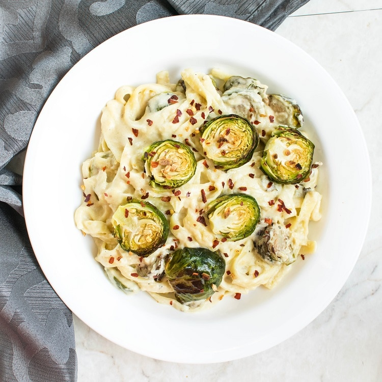 Top View of Roasted Brussel Sprouts Fettuccine Alfredo in a serving dish