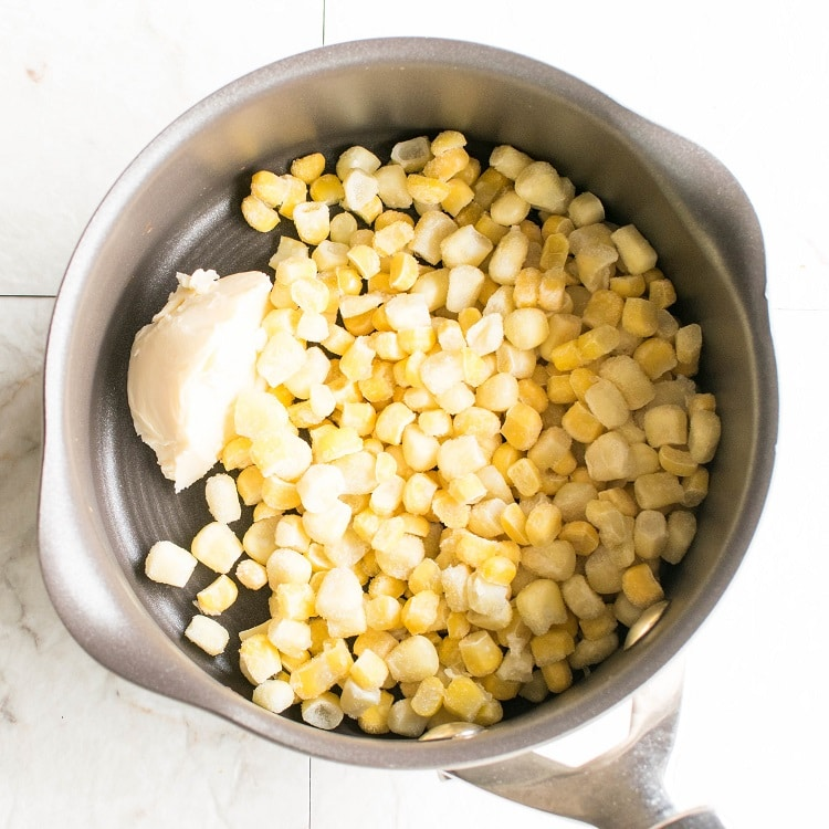 Vegan butter and corn kernels in a nonstick pot
