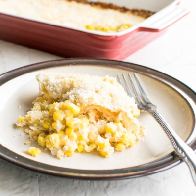 A portion of creamed corn casserole on a serving plate