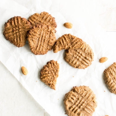 Top view of 3 ingredient almond butter cookies on a white sheet