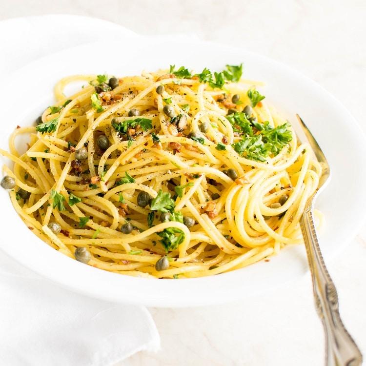 A 45 degree angle view of spaghetti aglio e olio
