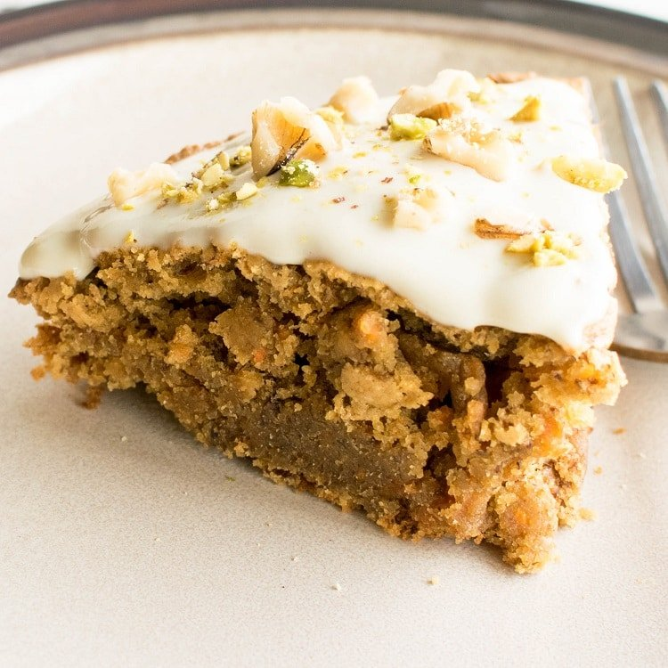 close up view of sliced vegan carrot cake with oat flour