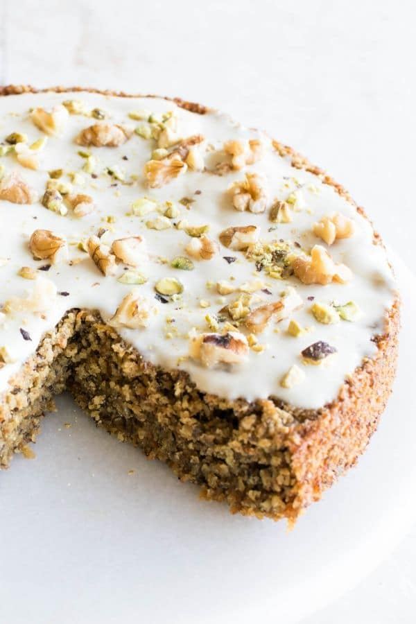 A 45 degree angle view of vegan carrot cake with oat flour