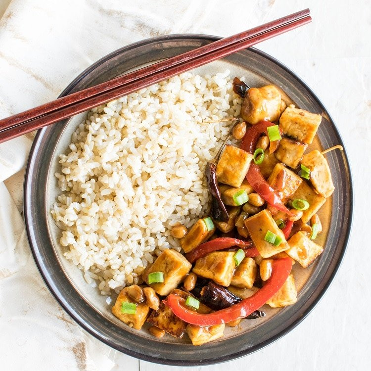 Top view of Kung Pao Tofu served with brown rice