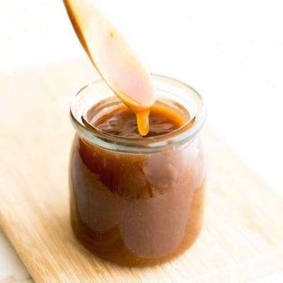 sweet and sour sauce dripping from a spoon