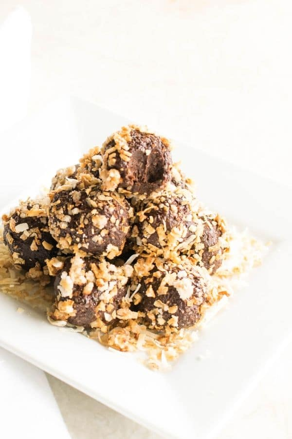 Half eaten chocolate truffle energy bites at the top of the stack