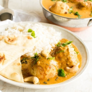Malai Kofta with naan and rice in a 45 degree angle view