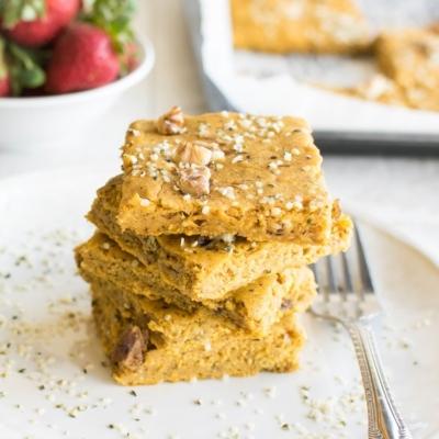 Front view of stacked sweet potato pancakes in sheet pan