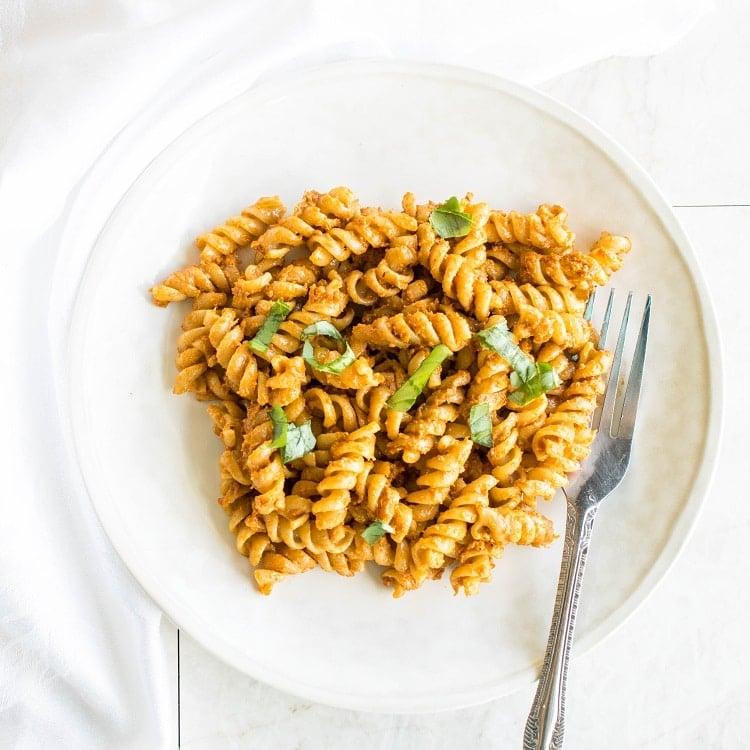 pasta tossed in sun dried tomato pesto