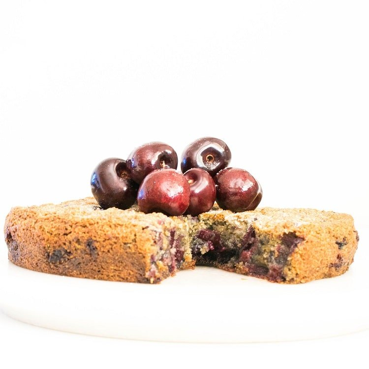 Full view of half eaten oil free cherry cake recipe