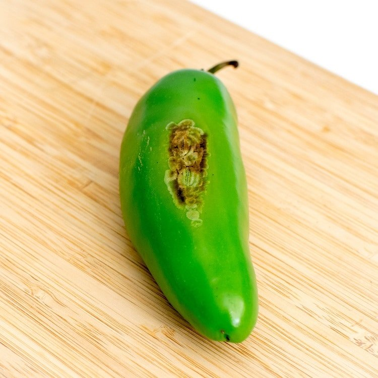 roasted jalapeno on a wooden board