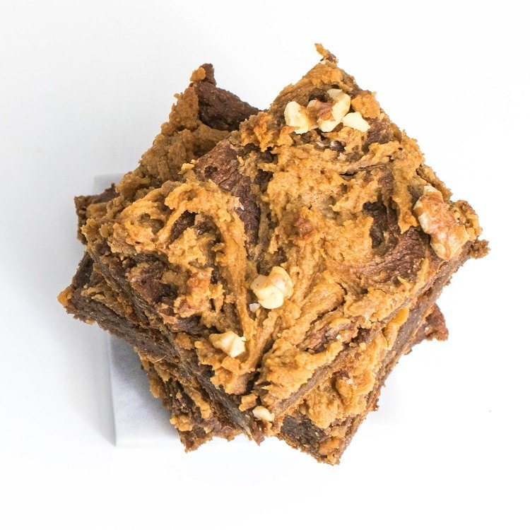 close up top view of stacked sweet potato brownies with chickpea flour