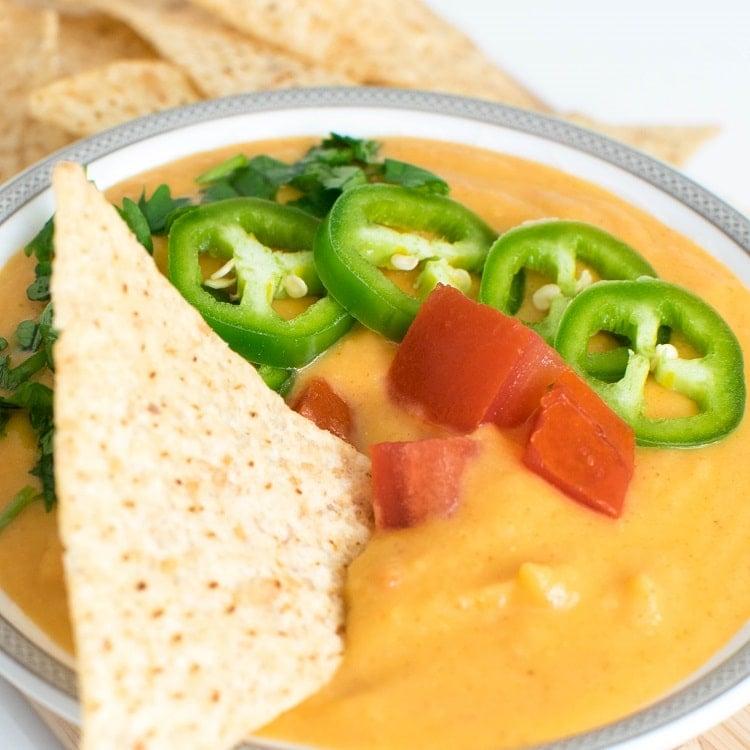 A close up view of vegan queso cauliflower dip