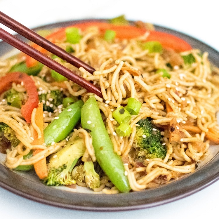 chop sticks in action to pick almond butter vegetable stir fry noodles