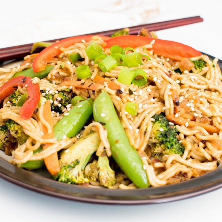 front view of almond butter vegetable stir fry noodles
