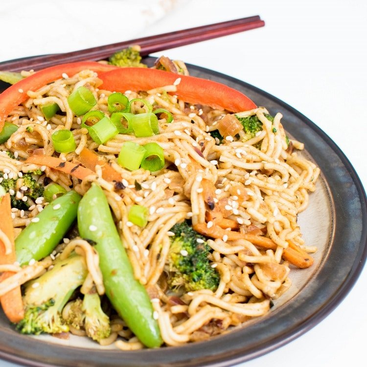 A 45 degree angle view of almond butter vegetable stir fry noodles