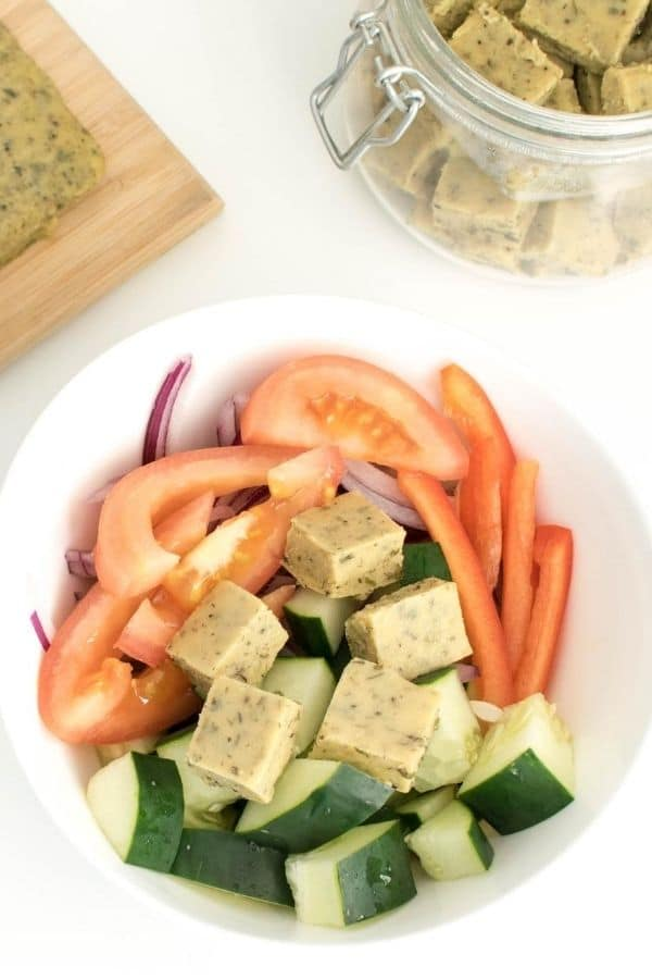 Top view of vegan feta cheese with chickpea flour