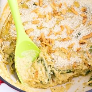 scooped vegan green bean casserole recipe from Dutch oven