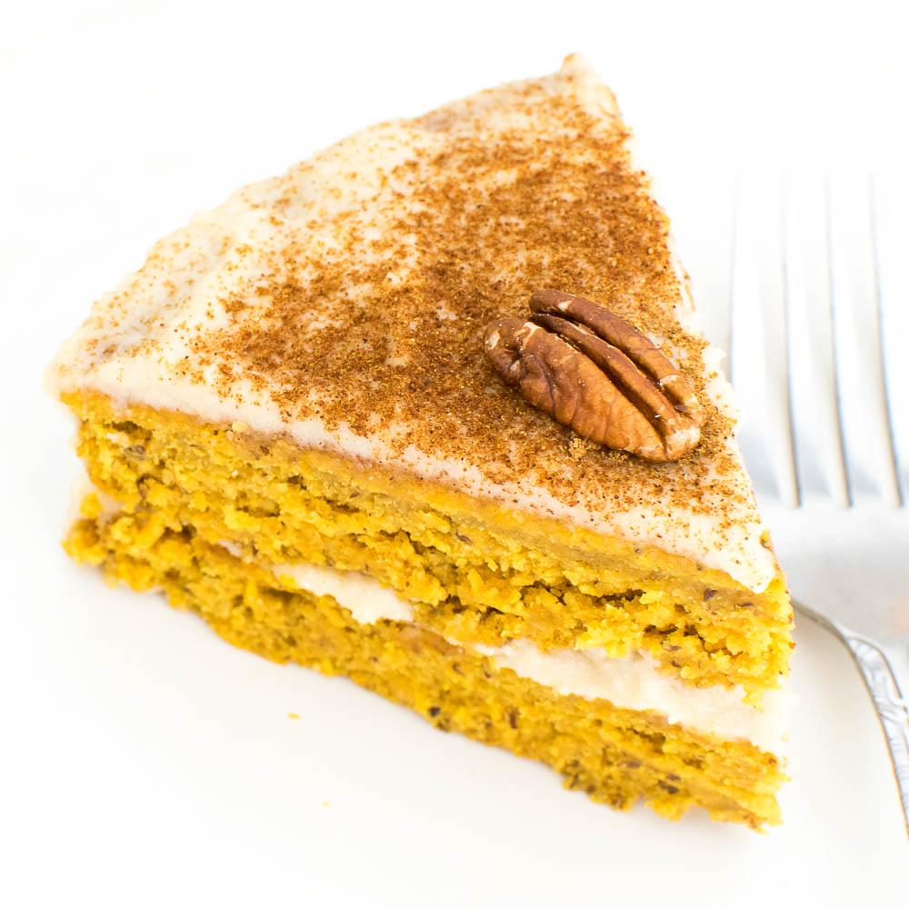 A close up view of a slice of pumpkin cake recipe with quinoa flour.