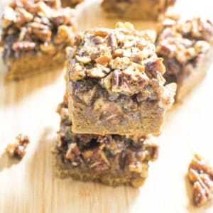 A close up view of stacked pecan pie bars