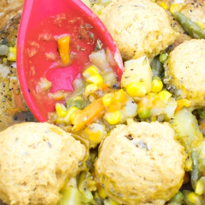 a close up view of vegan pot pie with chickpea flour biscuits