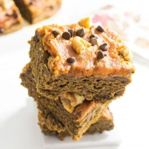 A 45 degree angle view of stacked pumpkin brownies.