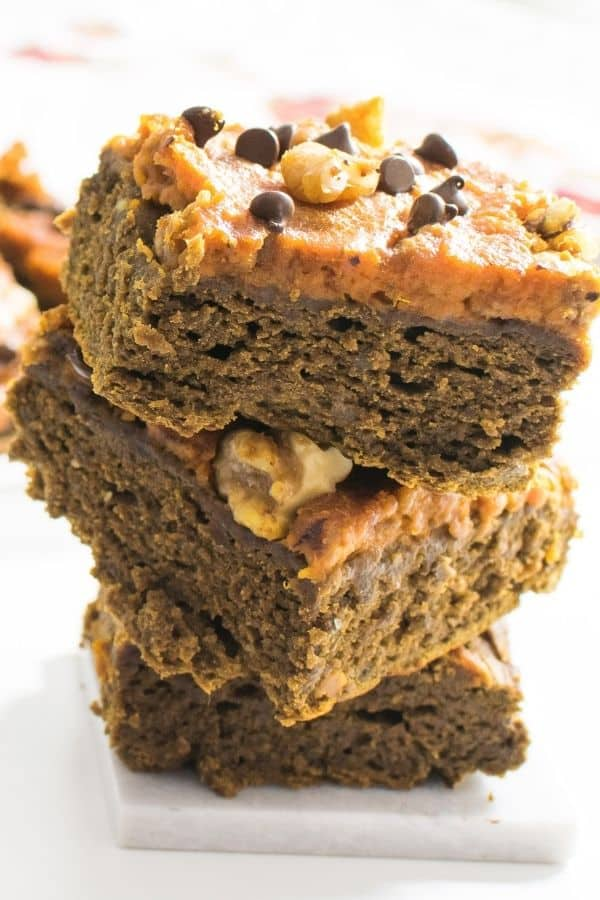 A front view of stacked pumpkin brownies.