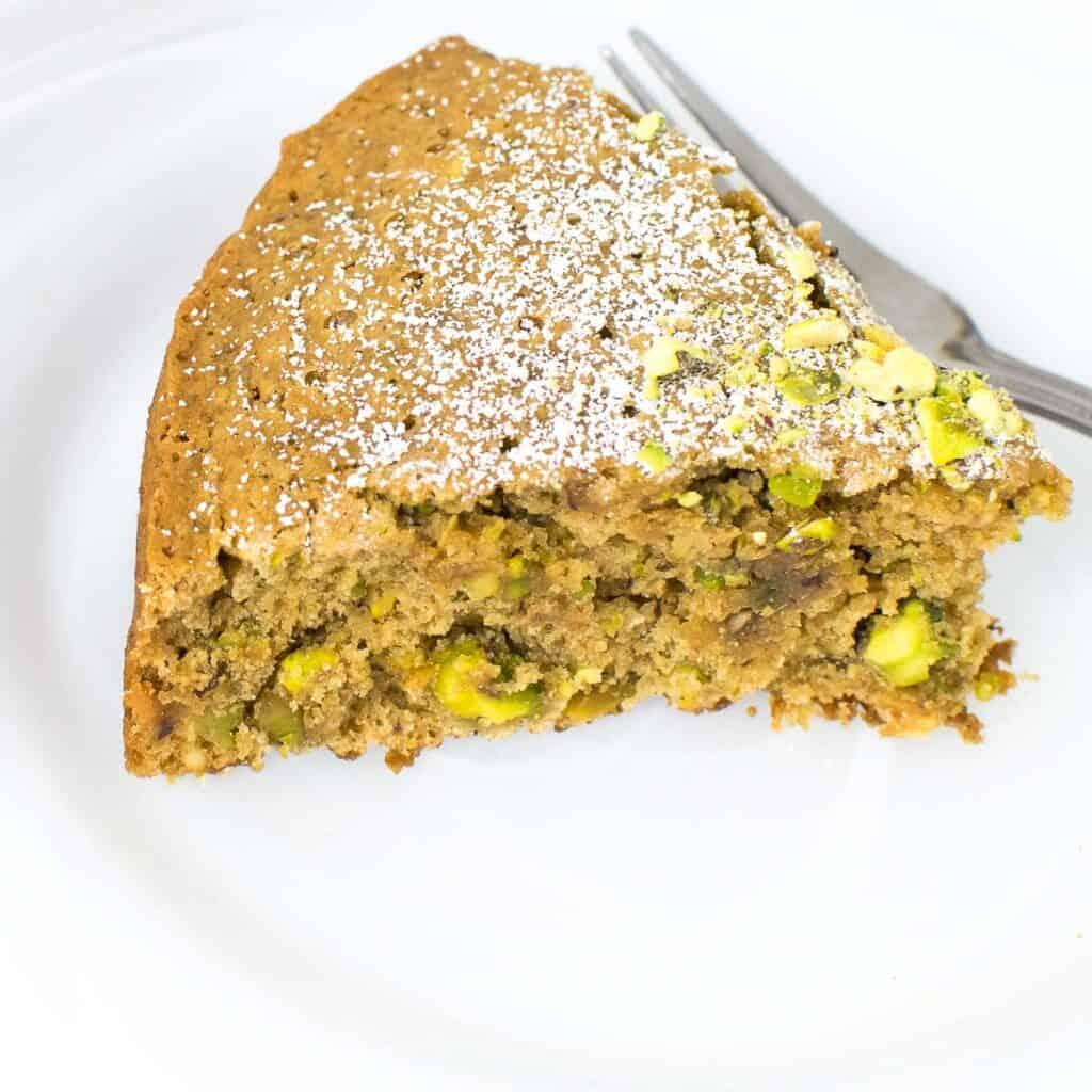 close up view of sliced pistachio cake.
