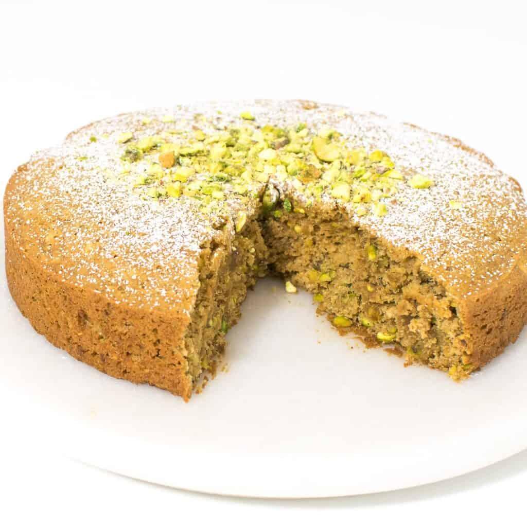 half sliced pistachio cake.