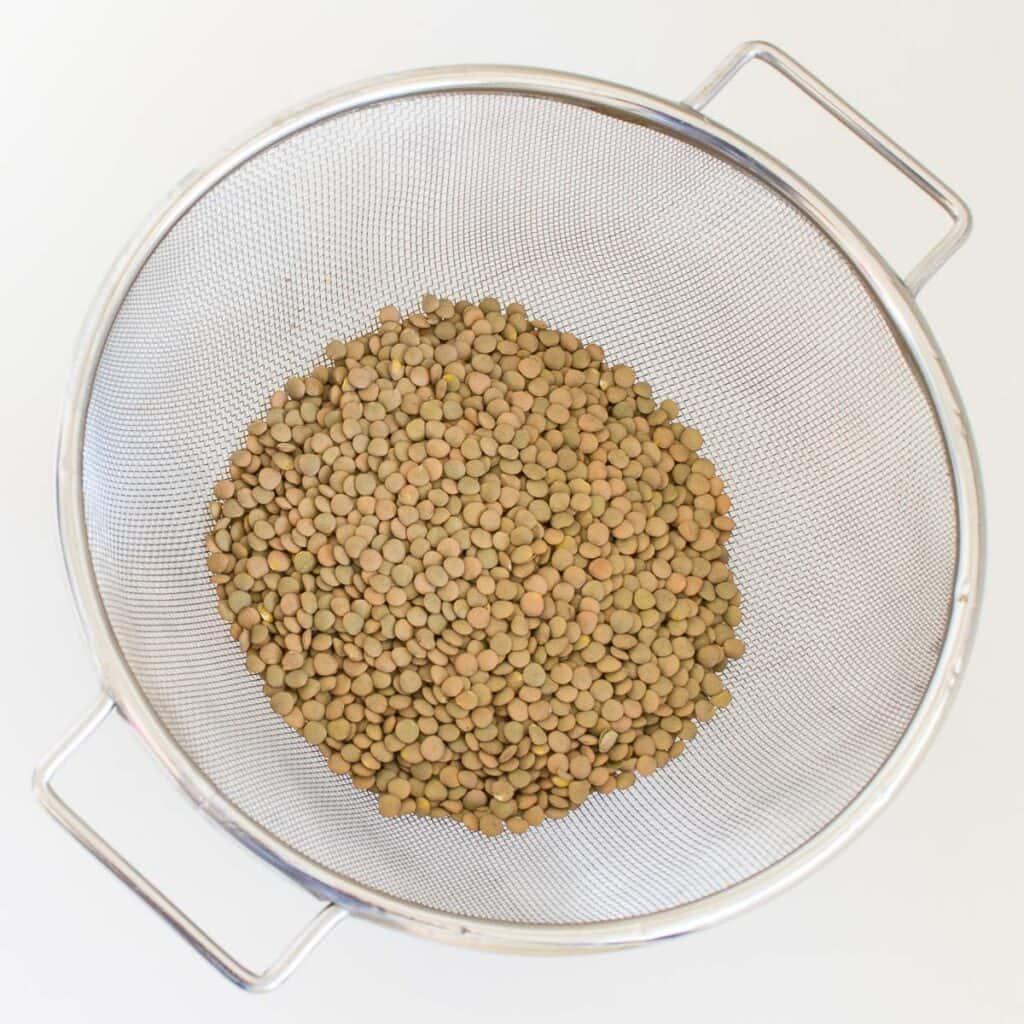 uncooked green lentils.