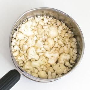 cauliflower boiling in a saucepan.